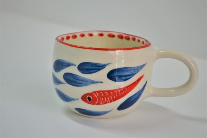 Short Uneven Cup A Red Fish in Blue ceramic